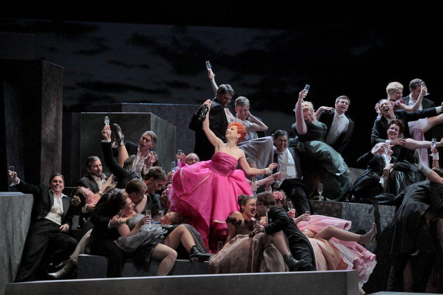 Woman in pink dress having a champagne celebration, La Traviata