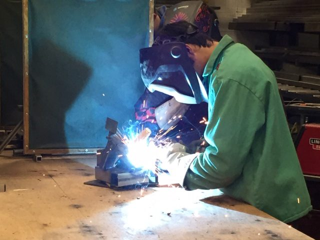 young technician welding